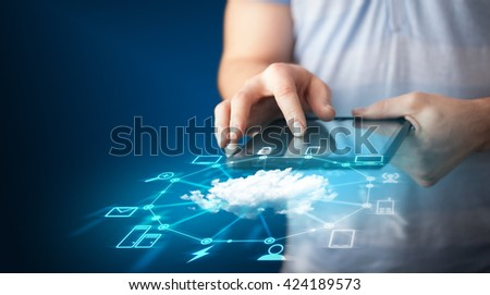 Close up of hand holding tablet with cloud network technology concept on background