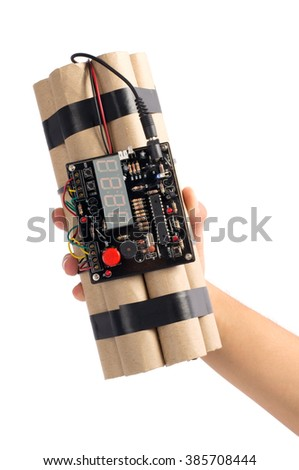 Close-up of hand holding time bomb isolated over white background. - stock photo