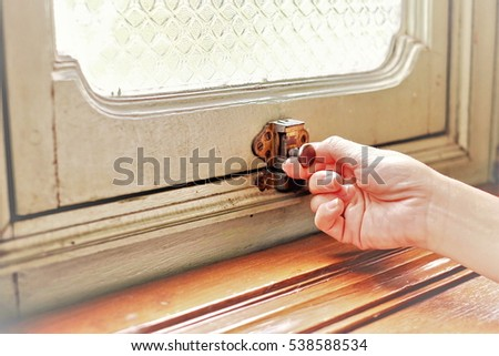 Close-up of hand holding window latch handle for open the window. & Window Latch Stock Images Royalty-Free Images \u0026 Vectors ... Pezcame.Com