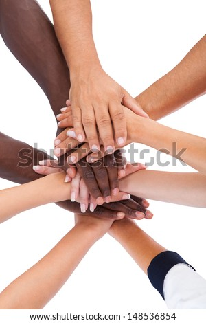 Close-up Of Hand Lying On Top Of Each Other Over White Background - stock photo
