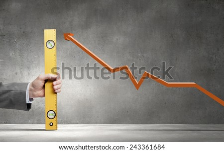 Close up of hand measuring increasing graph with ruler - stock photo