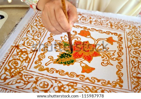 Close up of hand painting batik - stock photo