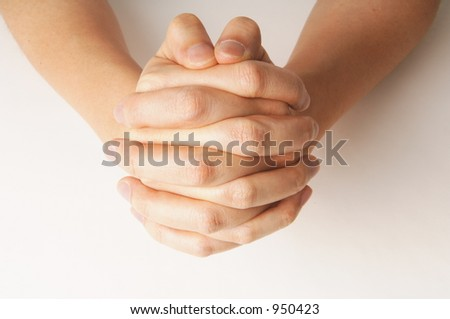 close up of hand praying