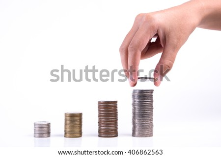 Close up of hand stacking coins on white background, Money growing concept, Save money with stack money coin for growing your business