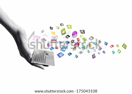 Close up of hand with laptop and media icons - stock photo