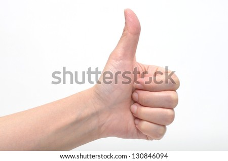 close up of hand with thumb up isolated on white background