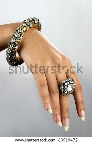 Close up of hand with traditional Indian diamond jewelery
