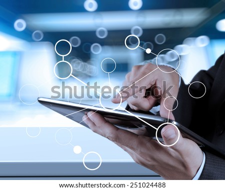 close up of hand working with digital tablet and blank flow chart on new modern computer as concept - stock photo