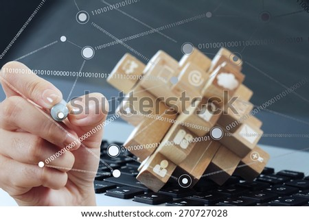 close up of hand working with new modern computer show social network structure as concept - stock photo