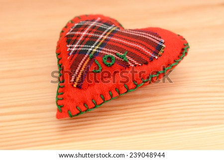 Close-up of handmade festive pomander, embroidered with the word JOY, on a wooden table - stock photo