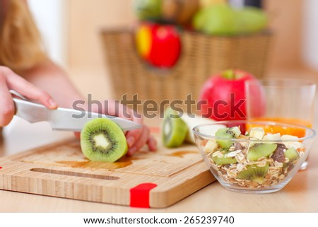 close up of hands cutting fruits - stock photo