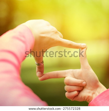 Close up of hands making frame gesture - stock photo