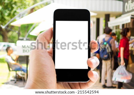 Close up of hands man using his cell phone,blurred background,people at coffee cafe - stock photo