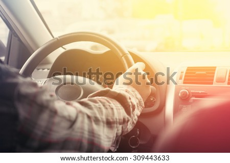Close-up of hands on a steering wheel