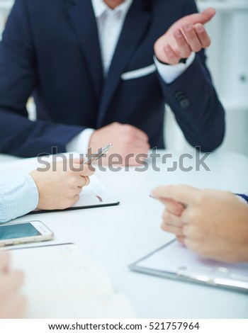 Close-up of hands on business meeting.