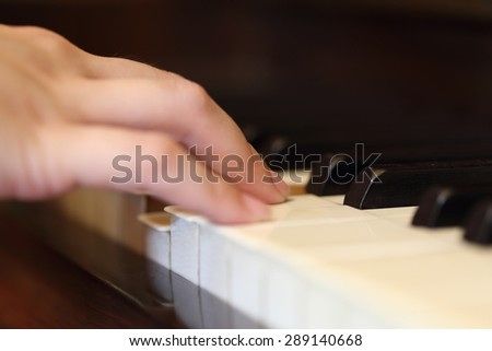 Close up of hands playing the classic wood  piano