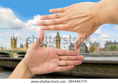 close up of hands symbol that means frame over Big Ben and Houses of Parliament in London - stock photo