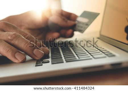 close up of hands using laptop and holding credit card with social media diagram as Online shopping concept - stock photo