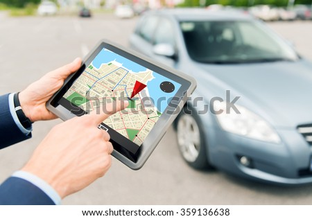 close up of hands with gps on tablet pc and car - stock photo