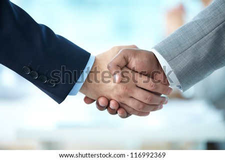 Close-up of handshake of business partners