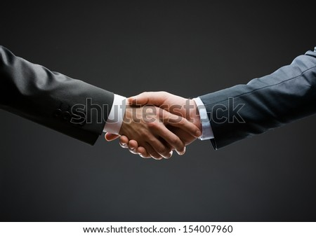 Close up of handshake of business people. Concept of trustworthy relations and business cooperation - stock photo