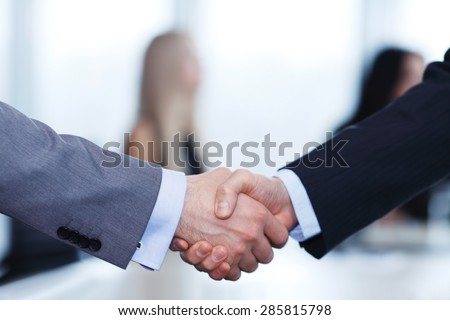 Close-up of handshake of businessmen on meeting in office