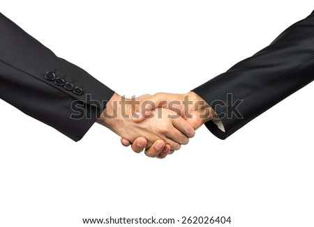 close up of handshake two business executives - stock photo