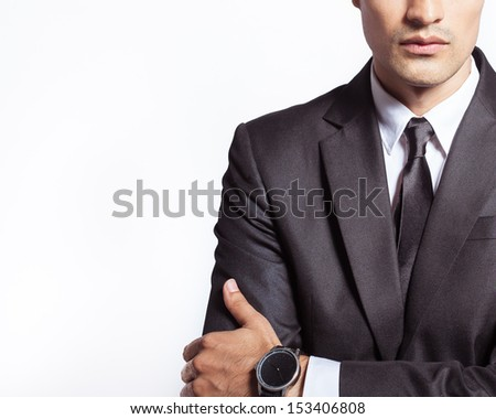 Close up of handsome businessman isolated on white background - stock photo