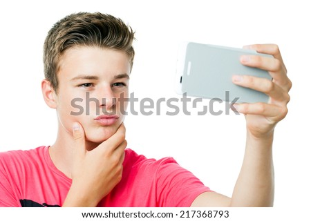Close up of handsome Teen boy taking self portrait with smart phone.Isolated on white background.