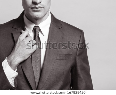 Close up of handsome young businessman - stock photo
