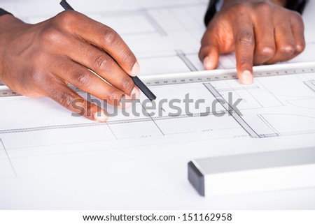 Close-up Of Happy Architect With Blueprint In The Office - stock photo