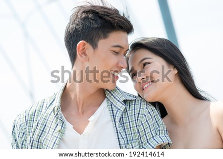 Close-up of happy Asian couple - stock photo