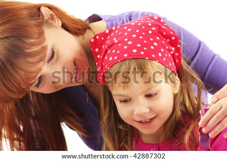 Close-up of happy mother and daughter on white background.