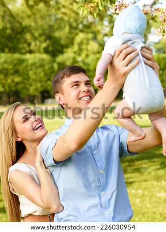 Close-up Of Happy Mother Looking At Father Carrying Her Baby - stock photo