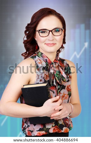 Close-up of happy young businesswoman - stock photo