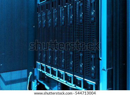 close-up of hard drives in modern data center. blue tone