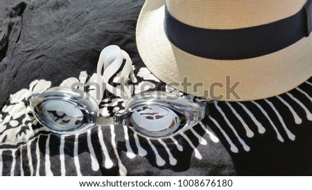 Close up of Hat, Sarong and Swimmers goggles