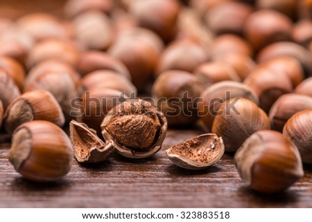 Close up of hazelnuts on a wooden table - stock photo