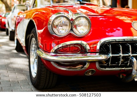 close up of headlights of red vintage car exhibition