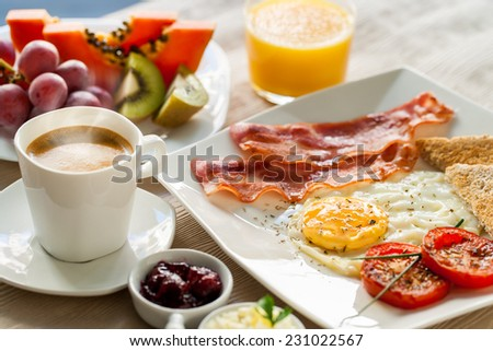 Close Up Of Healthy Continental Breakfast With Fresh Fruit And Ground Coffee
