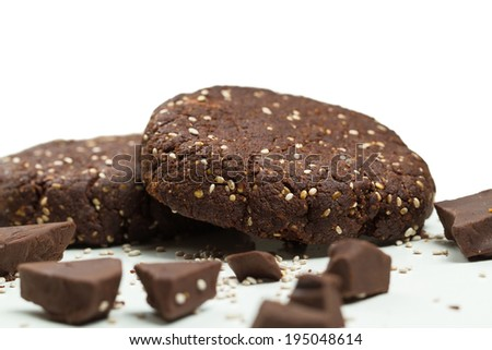 Close-up of healthy dark chocolate chia seed almond flour cookies on white background - stock photo