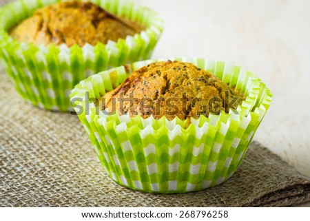 Close-up of healthy orange and poppy seed muffins  - stock photo