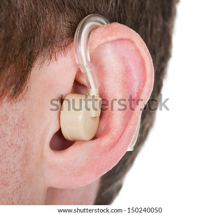 Close-up Of Hearing Aid On The Man's Ear - stock photo