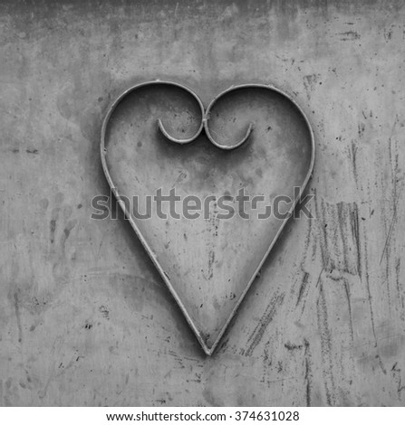 Close up of heart shape design of metal work on door.