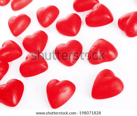 Close up of heart-shaped candies on white background