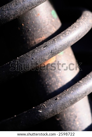 Close up of heavy guage springs found on a car shock absorber, abstract. - stock photo