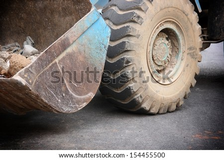 Close-up of heavy wheel loader. - stock photo