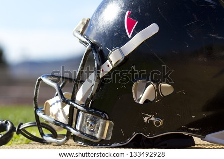 Close up of helmet use and striped rugby - stock photo