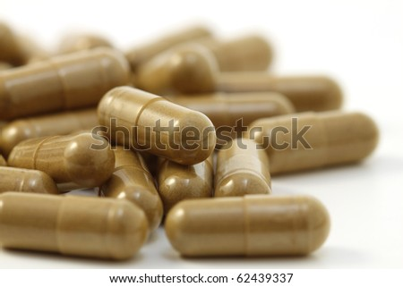 Close-up of herbs capsules. Isolated on white background. - stock photo
