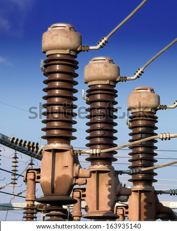 Close up of high voltage insulators - stock photo